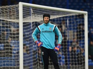 Cech in his hat, courtesy of Arsenal.com.