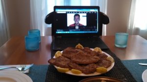 Mesut oversees the serving of pork schnitzel.