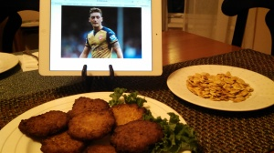 Ozil looks disdainfully at the frozen potato pancakes.