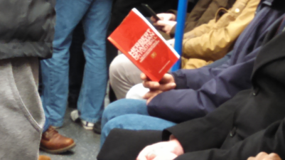 Man reading about Herbert Chapman on the train